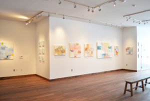 Wall of pink paintings, gallery view